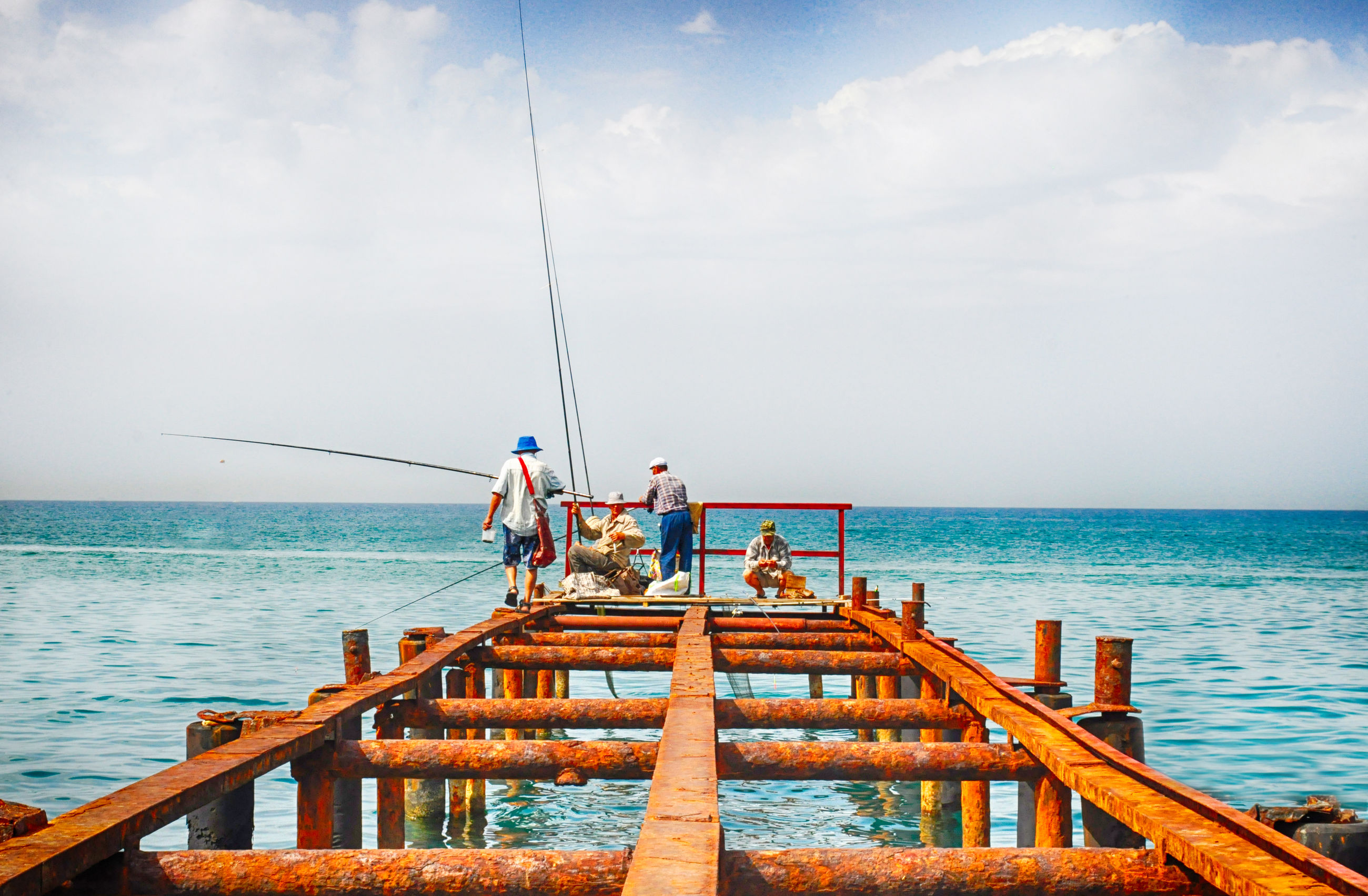 sea, water, horizon over water, men, sky, leisure activity, lifestyles, railing, pier, nature, scenics, person, medium group of people, blue, vacations, togetherness, beauty in nature, nautical vessel