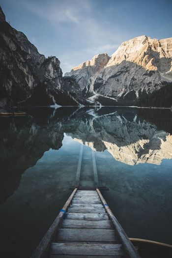 Scenic view of a lake reflecting mountains and sky