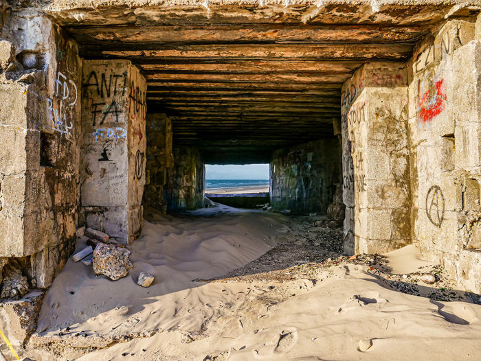 View of abandoned pier on beach