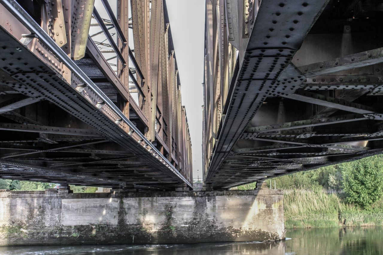 bridge, bridge - man made structure, connection, architecture, built structure, water, transportation, no people, river, day, underneath, nature, low angle view, metal, below, outdoors, city, waterfront, girder, arch bridge, long, overpass