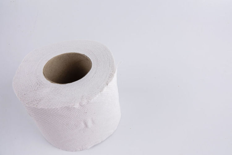 Close-up of toilet paper over white background