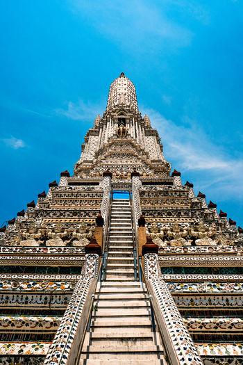 A nice view of wat arun under a beautiful sky in bangkok, thailand.