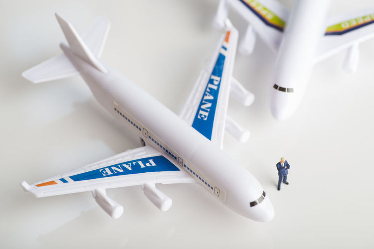 Miniature figures of a successful businessman with air transport background. Business Economy Industry Leader Logistics Passenger Transport Transportation Aerospace Industry Airline Airplane Aviation Businessman Cargo Commercial Concept Corporation Flying Freight Transportation Magnate Miniature Success Successful Travellers Tycoon