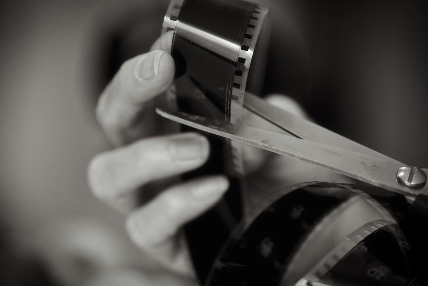 Cinema Analog Cut Film MOVIE Scissors Black And White Blackandwhite Close-up Holding Human Body Part Human Hand Monochrome Occupation Real People Selective Focus Skill  Working