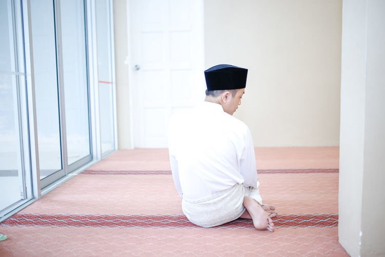Portrait of young handsome man performing pray in Islam way in mosque Celebration EyeEm Best Shots EyeEmNewHere Freshness Happiness Happy Love Man Praising The Lord Pray Tranquility Wedding Worship Cultures Day Grateful Handsome Indoors  Islam Islamic Light And Shadow Muslim One Person Outdoors Portrait