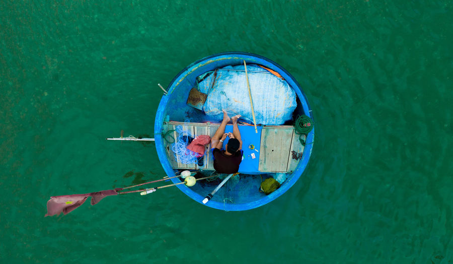 The daily activities in a fishing village in Mui Ne, Vietnam. Real People Water Nautical Vessel Transportation High Angle View Mode Of Transportation Nature One Person Day Sea Leisure Activity Directly Above Adult Outdoors Full Length Lifestyles Waterfront Men Women Boat Fishing Fish Asian  Floating On Water Ocean Bowl Aerial View