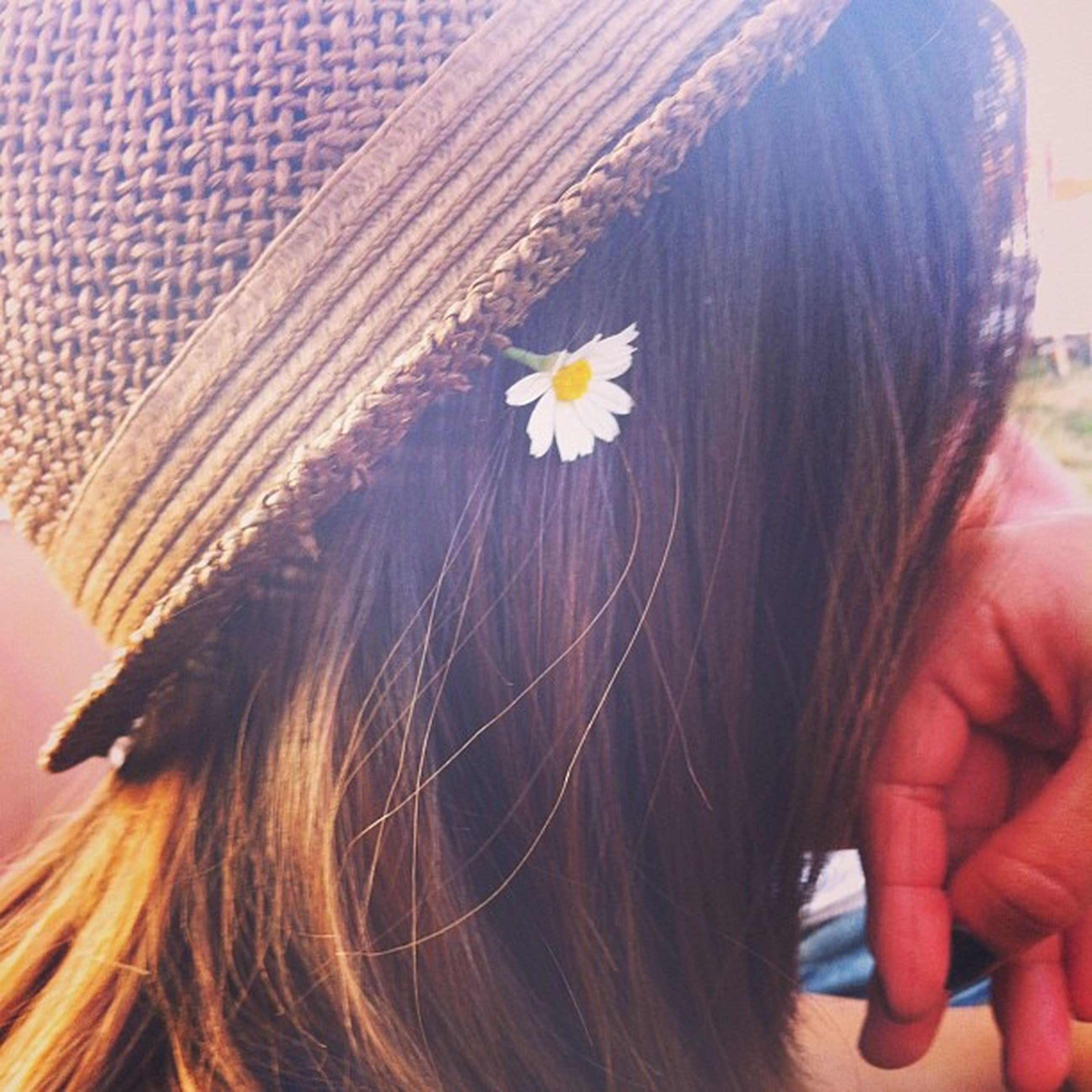flower, person, fragility, petal, flower head, freshness, holding, close-up, lifestyles, part of, focus on foreground, leisure activity, indoors, cropped, long hair, headshot