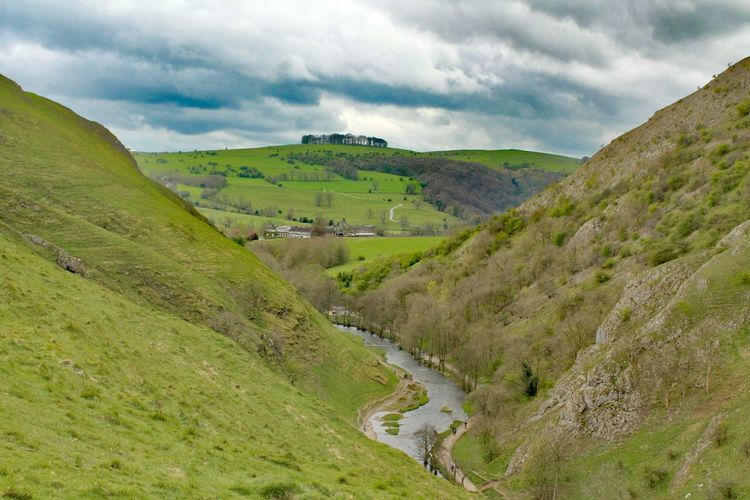 Landscape Rural Scene Nature Beauty In Nature Cloud - Sky Scenics Tranquility Hill Outdoors Tranquil Scene Green Color Day No People Agriculture Grass Sky Vacations Tree River Dovedale, UK