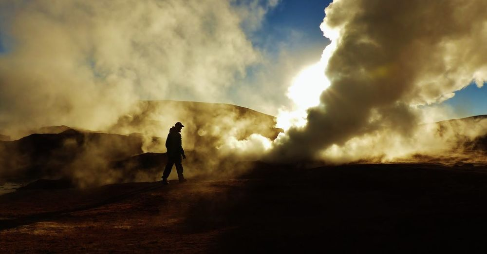 Geysers Bolivia Explore Natural Wonder Steam Mysterious Travel Adventure Silhouette Nature Geothermal  Geysers Geyser Sunrise Cloud - Sky Sky Smoke - Physical Structure Real People Men Outdoors One Person
