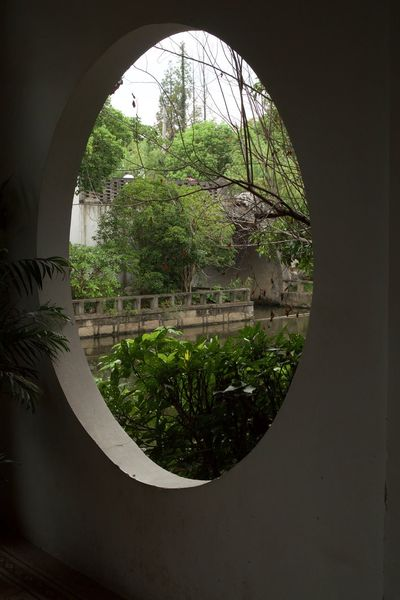 Arch Architecture Built Structure Chinese Culture Circle Day Garden Geometric Shape Green Green Color Growth Lush Foliage Nature No People Plant Sky Tranquility Tree
