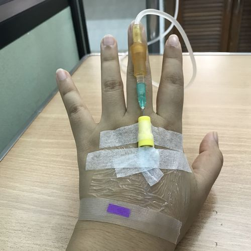 Body Part Close-up Finger Hand Healthcare And Medicine High Angle View Holding Human Body Part Human Finger Human Hand Human Limb Indoors  Multi Colored One Person Paper Personal Perspective Real People Table Unrecognizable Person Wood - Material