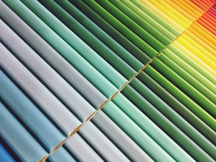 Full Frame Shot Of Colorful Rolled Up Papers Arranged