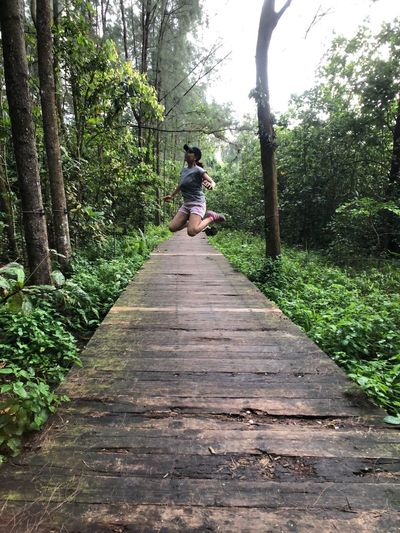 Jump Greenery Tree Plant Real People The Way Forward Direction Full Length Lifestyles Leisure Activity Nature Walking Footpath Outdoors Casual Clothing Day EyeEmNewHere