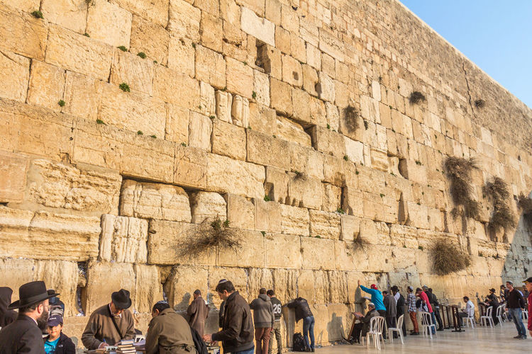 View of the Wailing wall in Jerusalem Western Wall Wailing Wall Jerusalem Architecture Group Of People Real People Built Structure History The Past Ancient Tourism Crowd Day Large Group Of People Men Travel Destinations Travel Lifestyles Building Exterior Leisure Activity Women Tourist Outdoors Ancient Civilization Stone Wall Archaeology