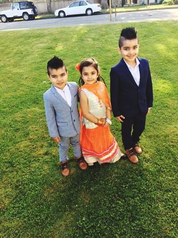 Boys Child Childhood Males  Grass Family Looking At Camera Son Day Smiling Outdoors Girls Portrait Togetherness People Happiness Men Standing Females Full Length