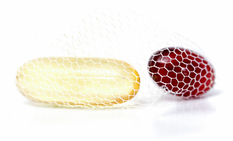 Capsule Close-up Fish Oil Healthy Lifestyle Mesh Fence No People Omega 3 Omega 3 Fatty Acids Red White Background