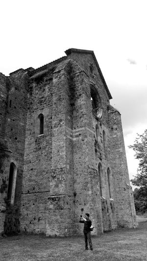 Built Structure Architecture Building Exterior Full Length Tower Medieval Outdoors History Old Ruin Casual Clothing Façade Sky Person Fortified Wall Castle The Past Day Tall - High Entrance Blackandwhite Photography Tuscany Discovertuscany Sangalgano Abbey Ruins Photooftheday