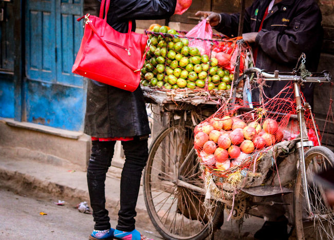 Fruit Variation Market Choice Freshness Retail  One Person Basket Healthy Eating Food Food And Drink Market Stall Casual Clothing Selling Large Group Of Objects Real People For Sale Outdoors Adults Only One Woman Only Kathmandu, Nepal Thamel Street EyeEm Best Shots Travel Travel Photography