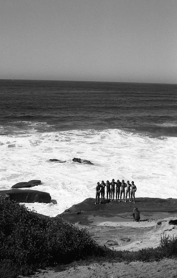 Analogue Photography Cali California California Dreamin EyeEmNewHere Ishootfilm Pacific WestCoast Analog Beach Black And White Film Photography Filmisnotdead Horizon Over Water Men Nature Ocean People Sky Standing Water Wave
