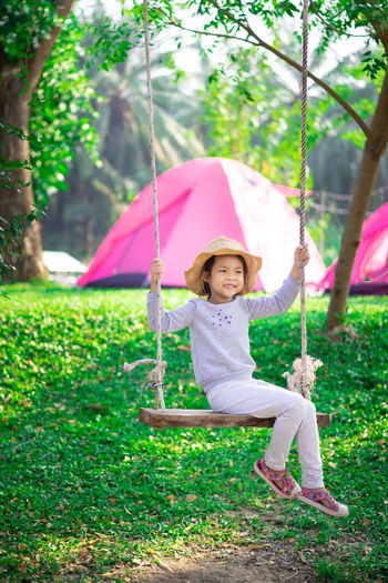 Portrait of smiling girl holding umbrella