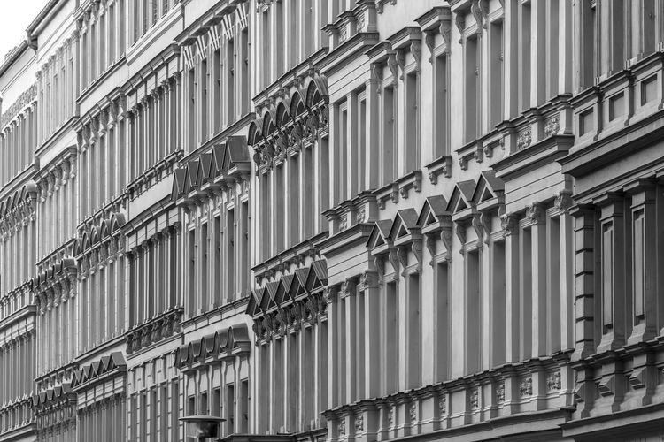 Apartment Architecture Urban Residential District Residential Building Black And White Old Historic Building Exterior Built Structure Building Low Angle View No People Full Frame Window Day Backgrounds City Pattern Outdoors Repetition Glass - Material Side By Side Nature Façade Apartment Building In A Row Street View Street Photography