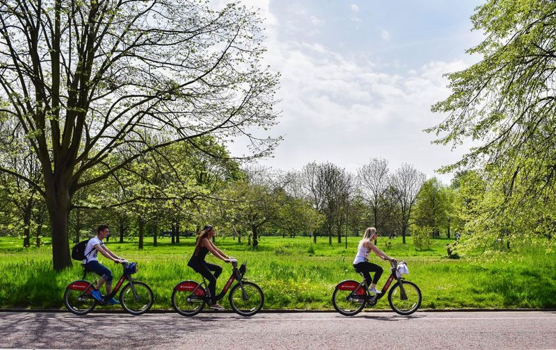 London Bicycle Day Field Full Length Grass Green Color Growth Hyde Park Land Land Vehicle Leisure Activity Lifestyles Mode Of Transportation Nature Non-urban Scene Outdoors Plant Real People Riding Sky Transportation Tree Women