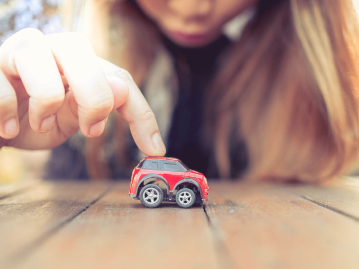 woman play toy car Boys Car Child Childhood Flooring Front View Hand Holding Human Hand Indoors  Innocence Leisure Activity Males  Men Offspring One Person Playing Real People Selective Focus Toy Toy Car