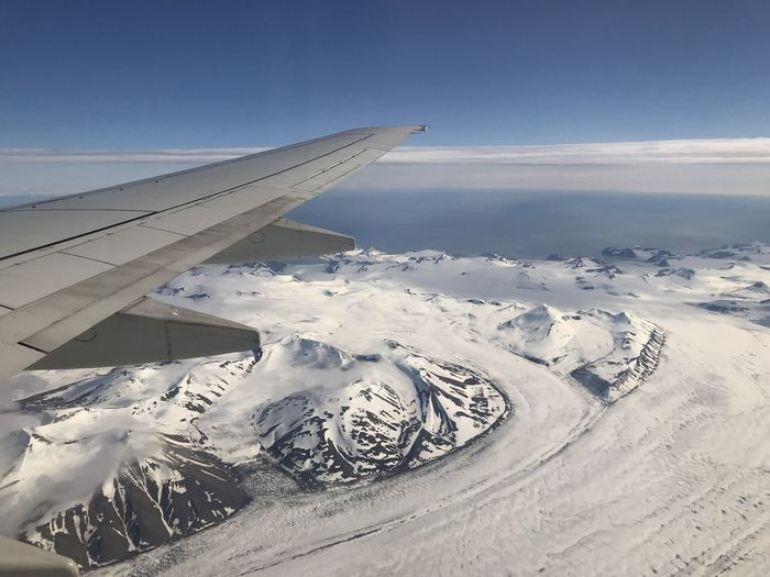 Aerospace Industry Air Vehicle Aircraft Wing Airplane Beauty In Nature Cloud - Sky Cold Temperature Day Environment Landscape Mode Of Transportation Mountain Mountain Peak Nature No People Scenics - Nature Sky Snow Snowcapped Mountain Transportation Winter