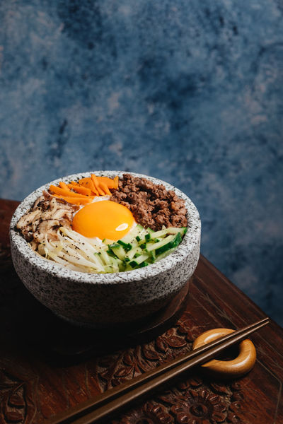 Bibimbap Breakfast Close-up Egg Egg Yolk Food Food And Drink Freshness Fried Fried Egg Healthy Eating Indoors  Japanese Food Kitchen Utensil Meal Ready-to-eat Steam Still Life Studio Shot Table Vegetable Wellbeing Wood - Material
