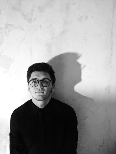 The Portraitist - 2017 EyeEm Awards Only Men One Man Only Adults Only Portrait One Person Adult People Mid Adult Mid Adult Men Looking At Camera Shadow Front View Men Indoors  Eyeglasses  Human Body Part Young Adult Day