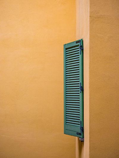 Window of orange wall