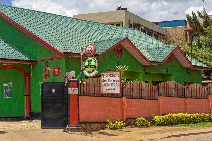 KIGALI,RWANDA - NOVEMBER 01,2017: Remera This the Master Grill in KG 113 Street.It's a mixture between a bar and a restaurant.Remera is mostly a business place with many banks,restaurants and shops. Kigali Rwanda Africa Architecture Building Exterior Built Structure Cloud - Sky Day Green Color No People Outdoors Sky Tree