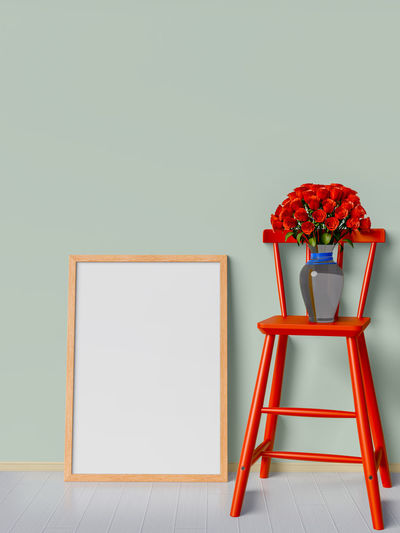 Copy Space Red Flower Indoors  Flowering Plant Plant No People Wall - Building Feature Nature Studio Shot Seat Vase Still Life Table Stool Multi Colored Art And Craft Chair Blank Vulnerability  Flower Head Flower Arrangement
