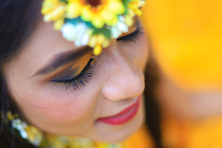 Close-up young woman during haldi ceremony