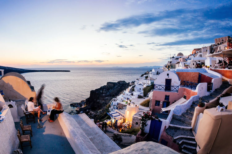 City Life Cloud Enjoying Life Greek Islands Horizon Over Water Leisure Activity Lifestyles Oia Oia Santorini Outdoors People Santorini Scenics Sea Tourism Tourist Travel Destinations Twilight Vacations Village Water