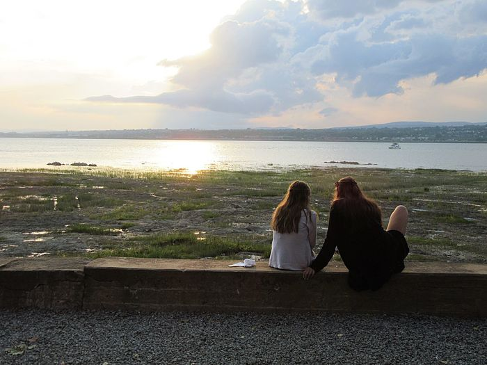 Two People Sitting Sea Water Togetherness Horizon Over Water Leisure Activity Relaxation Real People Sky Nature EyeEm Best Shots Lifestyles Women Beauty In Nature Scenics Tranquility Cloud - Sky Young Women Friendship River View Blue Sky Looking At View Riverside Friend Moments
