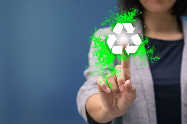 Digital Composite Image Of Woman Touching Recycling Symbol