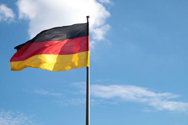German Flag Waving Against Sky