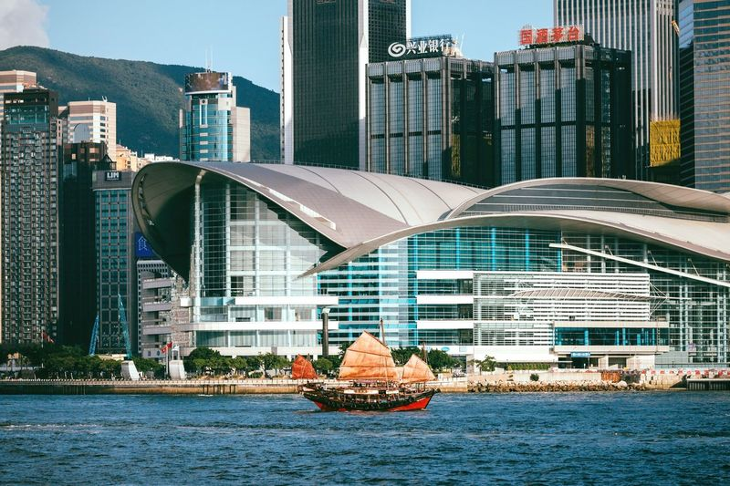 Junk boat Architecture Building Exterior City Built Structure Skyscraper Modern Urban Skyline Cityscape Outdoors Water Downtown District Nautical Vessel Waterfront City Life Travel Destinations No People HongKong Hong Kong Victoria Harbour Junk Boat Junkboat Urban Landscape Seaside Wanchai Connected By Travel