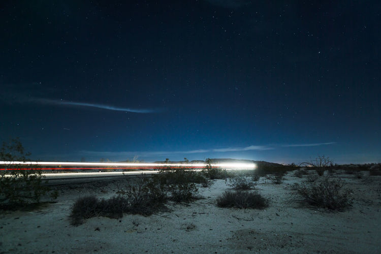 Light trails on country road at night