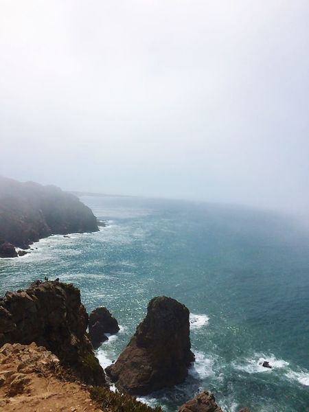 Cabo da Roca Ocean Sea Fog Europe Trip Europe Cabo De Roca Portugal Water Beauty In Nature Scenics - Nature Sky Rock Land Tranquility Beach Tranquil Scene Rock - Object Solid Horizon Over Water Nature Day No People Outdoors Idyllic Horizon