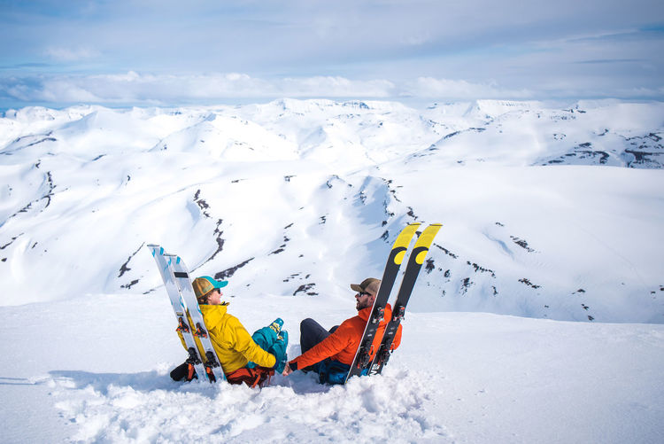 Person skiing on snowcapped mountain during winter