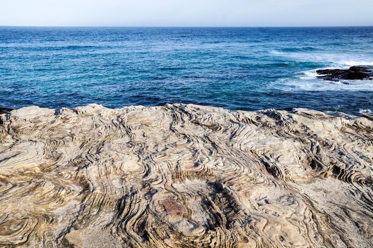 Rock Textured  Sea Water Beach Land Beauty In Nature Horizon Over Water Scenics - Nature Wave Outdoors Nature Horizon Day Tranquility