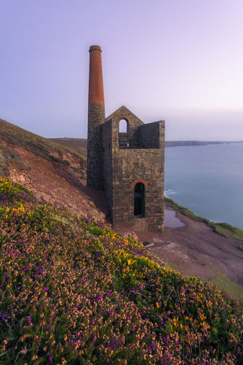 Towanroath Engine house between St Agnes and Chapel Porth in cornwall england UK Coastline Gorse Indistrial Path Beauty In Nature Copper  Cornwall Day England Heather Mining Nature No People Outdoors Poldark Purple Scenics Sky Sunset Tin Uk Wheal