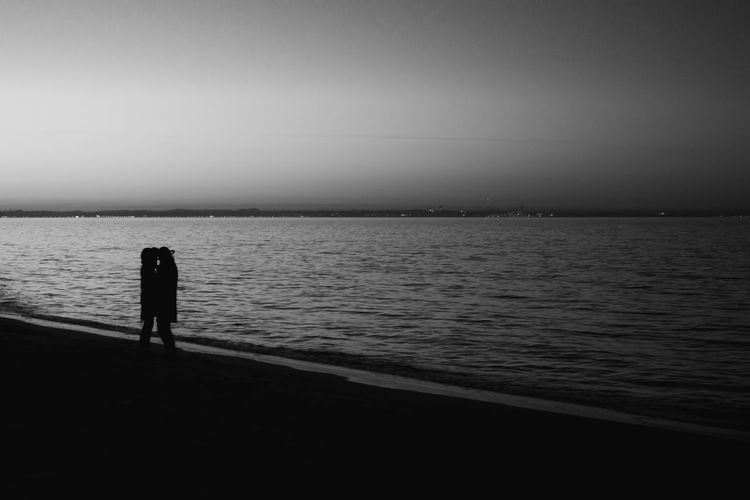 Blackandwhite Bkack And White Black And White Photography Love Lovers Lonely Water Sea Silhouette Standing Sky Rear View One Person Beach Land Tranquility Nature Full Length Tranquil Scene Horizon Leisure Activity Real People Solitude Scenics - Nature Horizon Over Water Outdoors Contemplation Looking At View