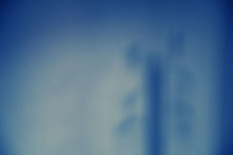Defocused image of blue sky seen through glass window