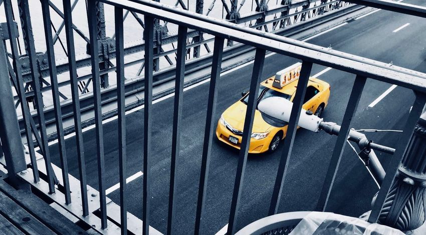 Brooklyn Bridge / New York Brooklyn New York City Taxi EyeEm Selects Metal Railing Day Security No People Safety High Angle View Barrier Transportation Built Structure Outdoors Pattern Mode Of Transportation