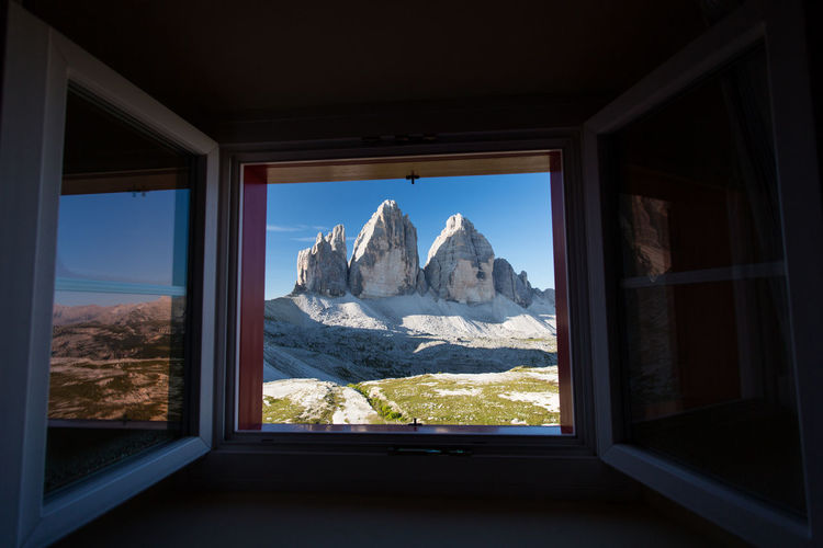 View of mountains through window