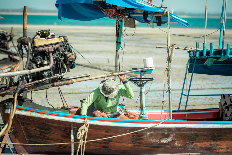 Water Nautical Vessel Mode Of Transportation Transportation Sea Day Focus On Foreground Moored Real People Nature One Person Occupation Fishing Fisherman Rope Outdoors Animal Working Fishing Industry Fishing Boat