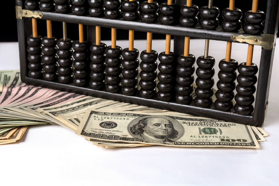 Money talk. Abacus Abacus Beads Business Concepts Cashier Machine Close-up Counting Currency Dollar Bill Financial History International Money Counter Money Talk Paper Currency Retail  Wealth White Background